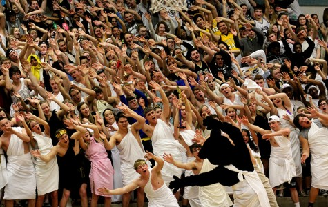 Chewy leads the student section in 'the roller coaster'