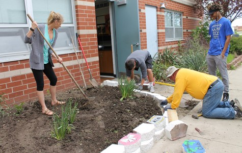 Students renovate garden with decorated bricks