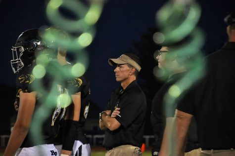 Observe. Watching the athletes' every move at the Ray-Pec vs. Park Hill home game, Trainer Dan Schwarz keeps a close eye on the team to look for any injuries. Schwarz has to lookout for the safety of the team.