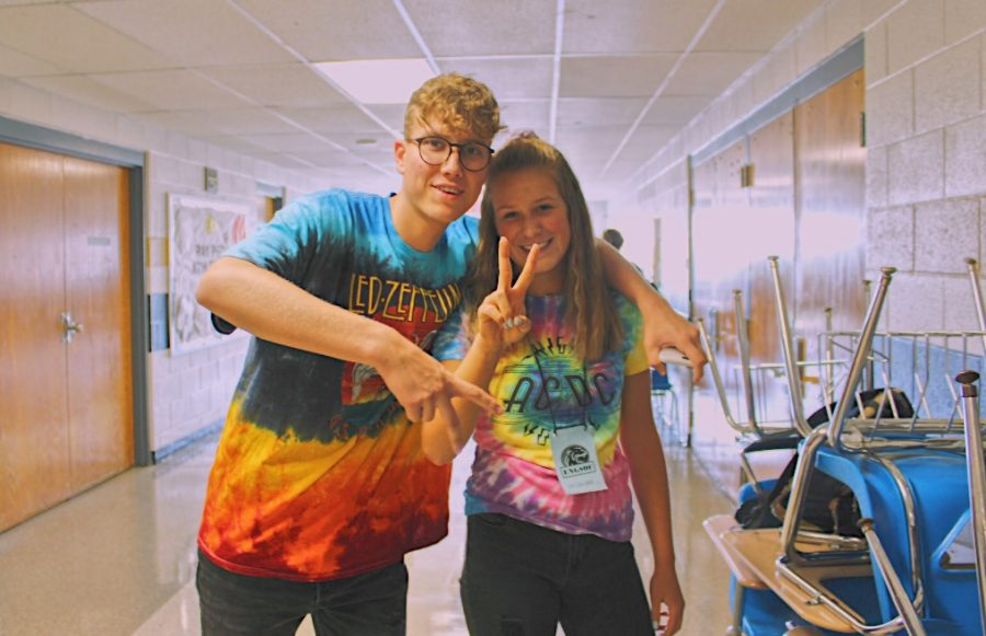 Friendship. Posing with their peace signs in honor of hippy day, Julia Dorweiler and Paul Hoppener show off their school spirit. Hoppener manages, and Dorweiler plays on the school volleyball team.
