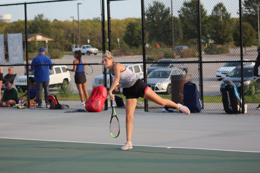 "Swing. 	Hitting the ball at a fast rate, Sophomore Peyton Koper focuses on her competitive tennis match. She has been playing tennis since freshman year and is now a varsity sophomore tennis player. ""It took a lot of hard work and motivation,"" said Koper."